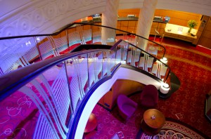 Float down the stairs of the Queen Mary 2